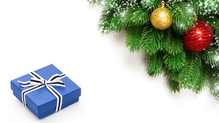 Christmas holidays decoration with blue gift box and fir branches isolated on white background