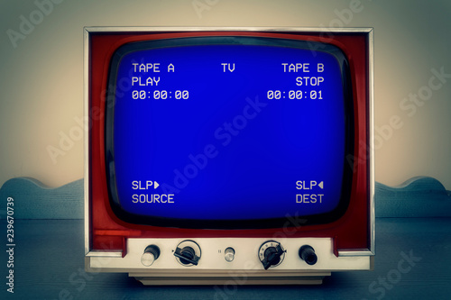 A retro vintage TV screen: a VCR double deck tracking an