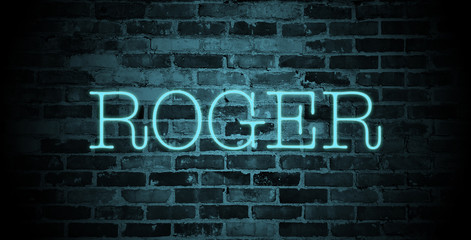 first name Roger in blue neon on brick wall