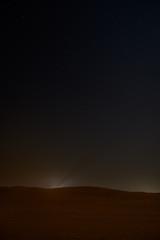Night sky with stars above arabian desert