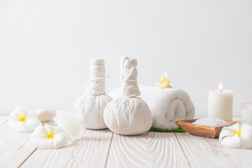 Spa herbal compressing ball with candle and orchid