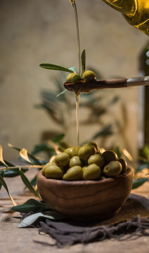 Virgin olive oil falling on a bowl