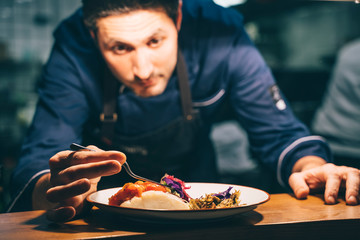 Chef putting delectable dish on plate