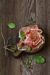 Parma italian dried ham on a wooden board