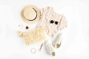 Wall Mural - Woman summer clothes travel, collage on white background. Straw hat, bag, sunglasses and sneakers. Top view, flat lay.