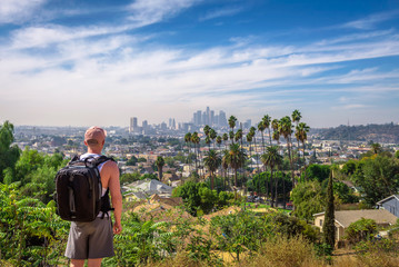 Wall Mural - Tourist looking at the downtown panorama of Los Angeles