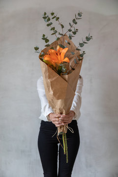 Young girl holding a bouquet of flowers