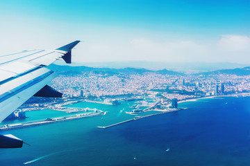 Landing in Barcelona, Spain, Catalonia. Traveling by air. View from airplane window.