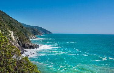 View on the shoreline around Vernazza with a rough sea