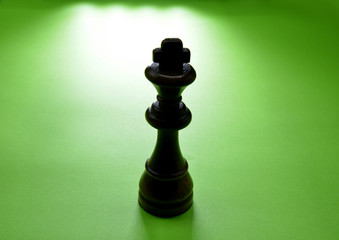 chess king on green background