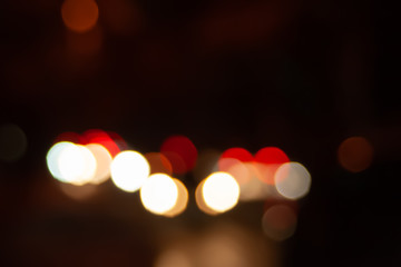 Blurred night background of city street road with bokeh effect. Abstract wallpaper for design and editing images.