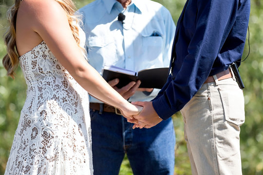 Hands Holding Each Other at Wedding Ceremony