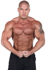 Bodybuilder posing in front of white background