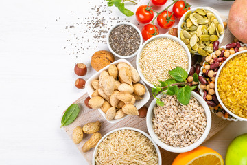 Selection of good carbohydrates sources - vegetables, fruits, grains, legumes, nuts and seeds. Healthy vegan diet Wall mural