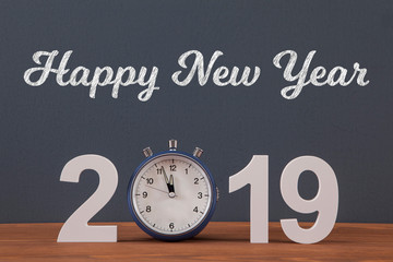 New year concepts countdown clock with blue clock on the wooden table