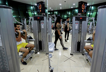 Dina Abdel-Maksoud, a 21-year-old Egyptian bodybuilder champion, is seen during training at a gym in Port Said