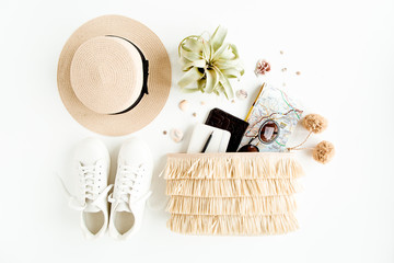 Wall Mural - Woman fashion travel. Straw hat, bag with accessories, sneakers, succulent, sunglasses. Flat lay. Top view