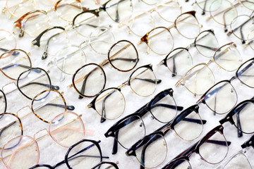 Glasses, Eyeglasses Optical Store, Fashion eyewear at night market, Colorful glasses, Glasses on shelf, Glasses in optical store shopping mall (Selective Focus) Wall mural