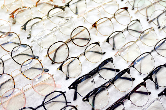 Glasses, Eyeglasses Optical Store, Fashion eyewear at night market, Colorful glasses, Glasses on shelf, Glasses in optical store shopping mall (Selective Focus)