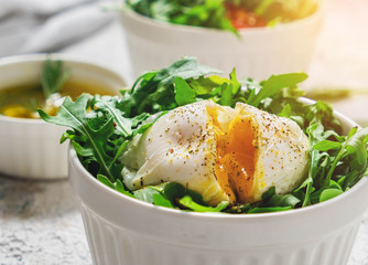 breakfast, salad with arugula and poached egg