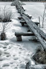 wooden walkways over the water in winter