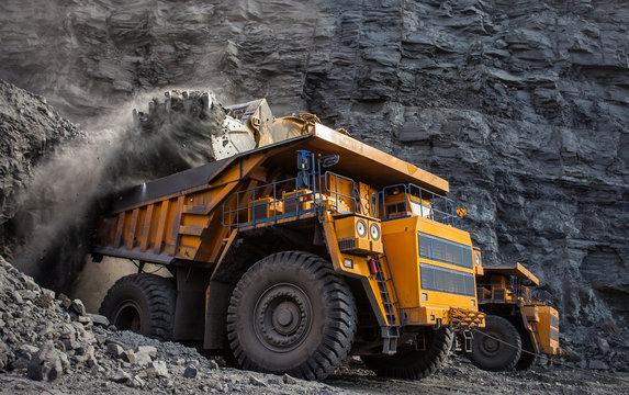 mining truck in a coal mine loading coal