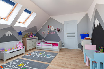 Modern bedroom for boy and girl with furnitures and toys