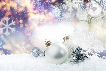 Christmas balls in snowflakes on background