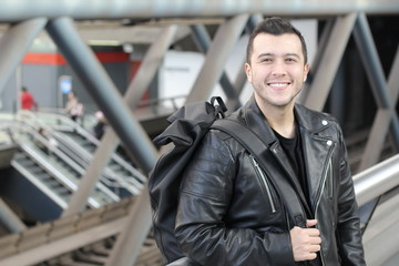 Cute ethnic man wearing leather jacket