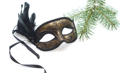 Image of elegant black and gold venetian, mardi gras mask on white snow background. Vintage photo. Christmas New Year carnaval Party night conception. Venice Carnival mask, close up