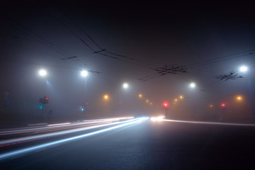 Night city street road covered by fog