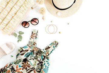 Wall Mural - Female, summer street style. Sundress-dress, straw hat, bag, sneakers, sunglasses and tropical leaf. Top view, flat lay.