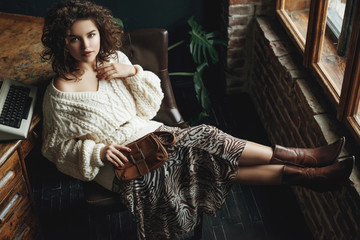 Full body fashion portrait of young beautiful confident woman wearing cozy white knitted sweater,...
