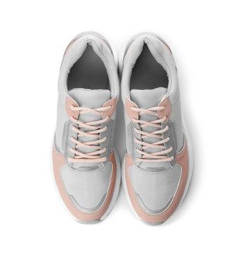 Pair of stylish sneakers on white background, top view
