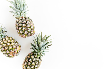 Pineapples isolated on white background. Food concept. Flat lay, top view