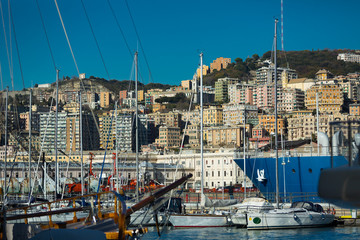 Old port of Genova city with boats at quay, Italy