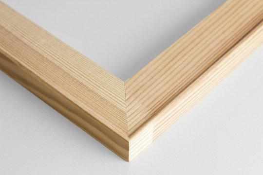 Corner of wooden subframe on gray background.