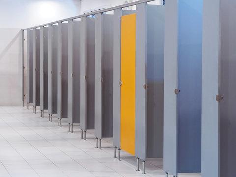 Empty public toilet interior.