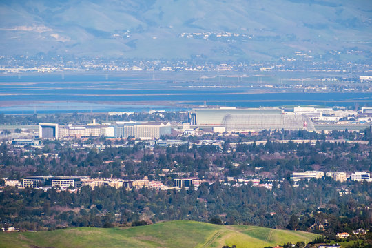 Aerial view of the NASA Ames Research Center and Moffett field on the shoreline of south San Francisco bay area, Mountain View, California