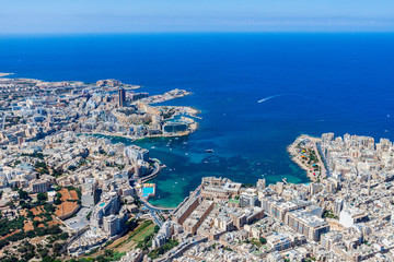 Malta aerial view. St. Julian's (San Giljan) and Tas-Sliema cities. St. Julian's bay, Balluta bay, Spinola bay, Towns, harbours and coastline of Malta from above. Skyscraper in Paceville district