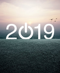 2019 start up business flat icon with green grass field over aerial view of cityscape at sunset, vintage style, Happy new year 2019 cover concept