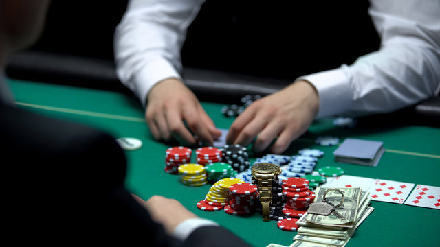 Addicted poker player going all-in, betting chips, money and property, reckless