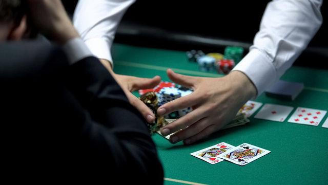 Unfortunate casino player losing all money, going bankrupt, gambling addiction