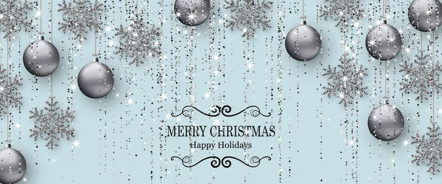 Merry Christmas background with shiny snowflakes, silver balls and grey colored tinsel and streamer. Greeting card and Xmas template