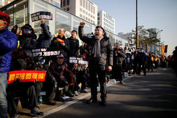 Taxi drivers take part in a protest against a carpool service application launched by Kakao Corp in Seoul