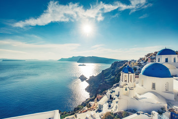 Photo on textile frame European Famous Place Churches in Oia, Santorini island in Greece, on a sunny day.