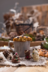Fragrant coffee, chocolates in the form of Christmas figures. Cookies and hot drink for the holiday. Cozy atmosphere, candles decor. free space for text.