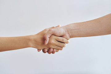Close-up image of man and woman shaking hands Wall mural