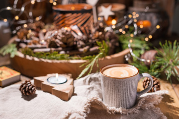 Fresh aromatic coffee and Christmas decor. Cozy festive atmosphere with candles and drinks. Free space for text