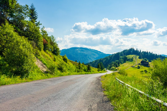 road through rural area in mountains. beautiful summer landscape. travel concept